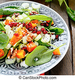 nourishing salad with celery and pumpkin, food closeup