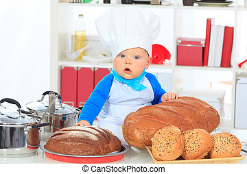 nourishment - Cute small baby in the cook costume at the...