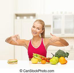 nourriture, comparer, femme, hamburger, fruits