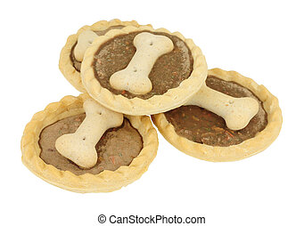 Novelty dog treat tarts decorated with a bone shape biscuit ...