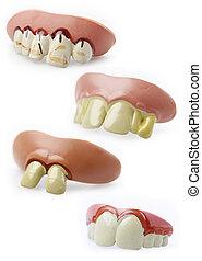 Four novelty teeth on plain background
