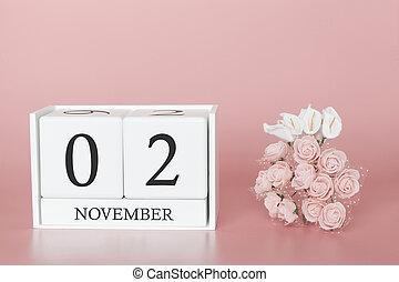 November 02nd. Day 2 of month. Calendar cube on modern pink background, concept of bussines and an importent event.