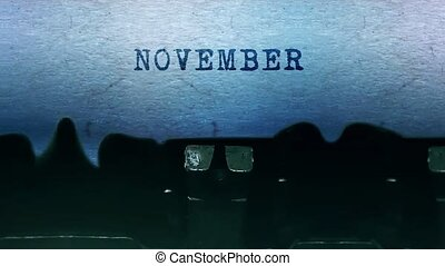 November Word closeup Being Typing and Centered on a Sheet of paper on old vintage Typewriter mechanical 4k Footage Background Animation.