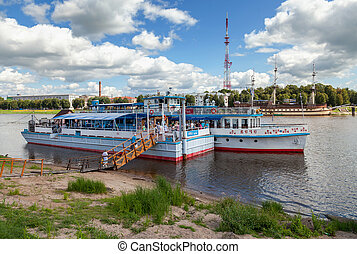 NOVGOROD, RUSSIA - AUGUST 10: River cruise passenger catamaran at the moored on Volkhov river on August 10, 2013 in Novgorod. Novgorod - famous ancient Russian city