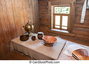 Interior of old rural wooden house in the museum of wooden archi
