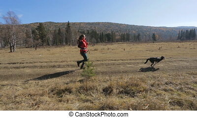 novice athlete walking with a running dog on a treadmill...