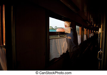 Novosibirsk, Russia-July 22, 2010. A man contemplates a sunrise from the window of a train crossing Siberia