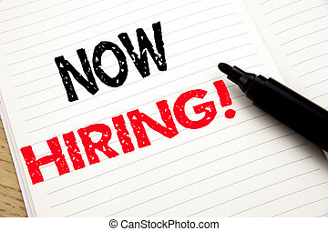 Now Hiring. Business concept for Hire Recruitment written on notebook with copy space on book background with marker pen