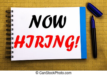 Now Hiring. Business concept for Hire Recruitment Written on notepad note paper background with space office view with pencil marker