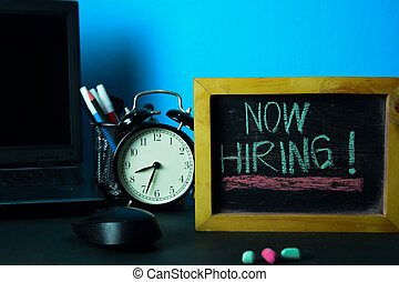 Now Hiring! Planning on Background of Working Table with Office Supplies. Business Concept Planning on Blue Background
