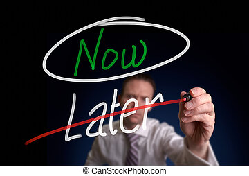 Now Not Later - A businessman writing a, Choosing Now...