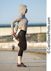 nowoczesny, młody, ma na sobie kobietę, rozciąganie noga, mięśnie