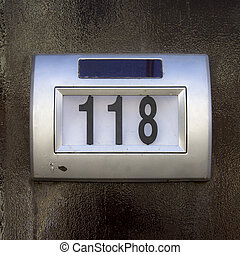 house number 118 on a solar powered device, so it will be lit at night