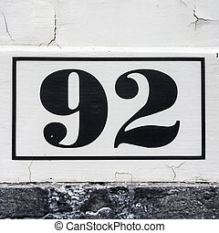 Nr. 92 - house number ninety-two. Black lettering on a white...