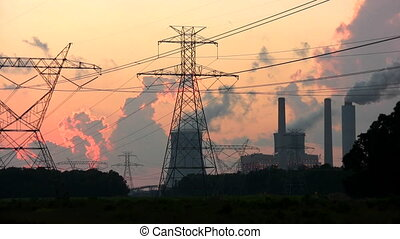 Nuclear Power Plant - Steam rises from the cooling towers at...