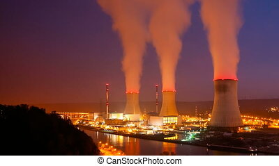 Nuclear Power Station At Night - Time lapse sequence of a...