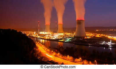 Nuclear Power Station At Night Time - Time lapse sequence of...