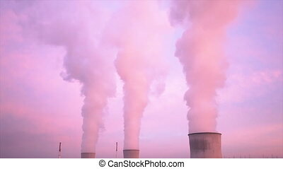 Nuclear Power Station At Sunset - Cooling towers and steam...