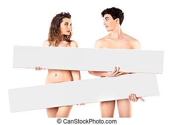 Nude attractive couple with empty boards - Nude attractive...