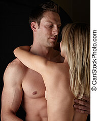 Nude Couple - Young and fit caucasian adult couple in an...