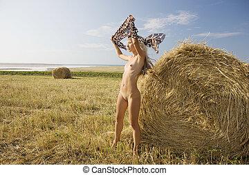 Nude girl sunbathing .