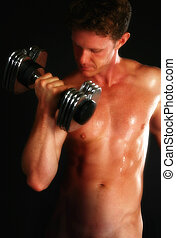 Nude Male - Attractive nude male lifting weights over black...