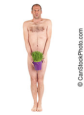 nude man and grass - nude man standing and holding grass...