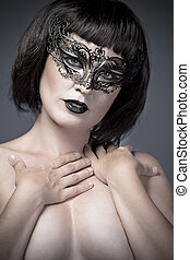Nude woman, beautiful young in a black mysterious venetian mask