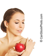 Nude woman holding an apple