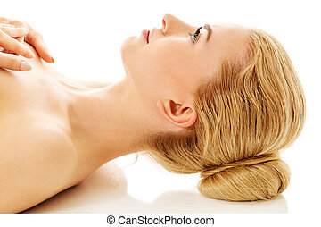 Nude woman lying on the floor