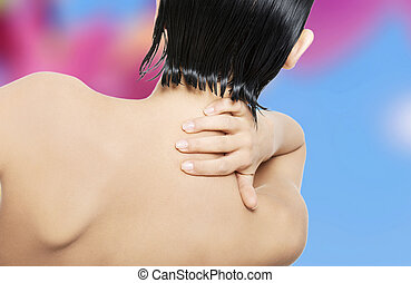 Nude woman with back pain