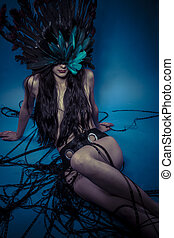 Nude woman with fantasy feathers dress