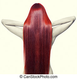 Portrait of beautiful young nude woman with long red hair. View from back side