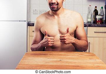nudo, giovane, in, suo, cucina, dare, pollici