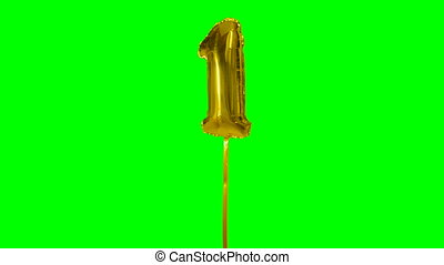 Number 1 one year birthday anniversary golden balloon floating on green screen