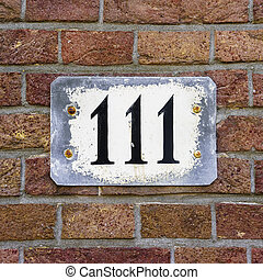 Number 111 - House number one hundred and eleven, nailed to...