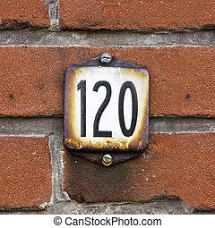 Number 120 - Enameled house number one hundred and twenty....
