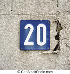 Number 20 - house number twenty embossed in a metal plate