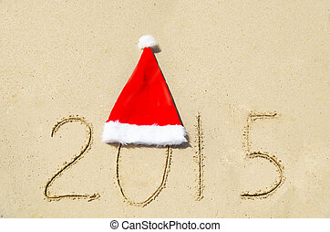 Number 2015 on sandy beach - holiday concept