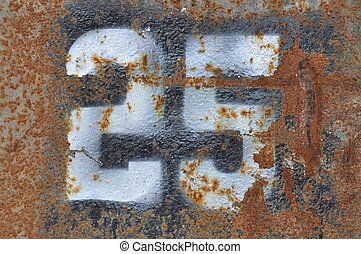 Number 25 on rusty metal surface