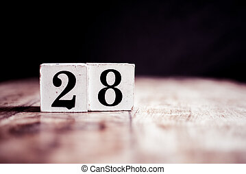 Number 28 isolated on dark background- 3D number twenty eight isolated on vintage wooden table