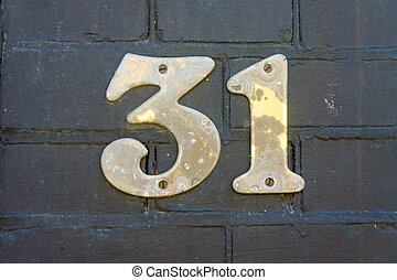 Number 31 - weathered house number thirty one (31).