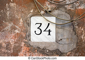 Number 34 - House number thirty four (34)