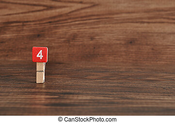 Number 4 displayed on a wooden background