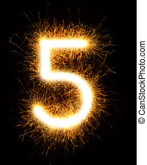 Number 5 drawn with spaklers on a black background