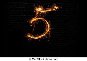 Number 5 made of sparklers on black