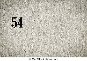 Number 54 on cement wall