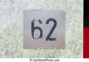 Number 62 - House number sixty two (62) engraved in a...