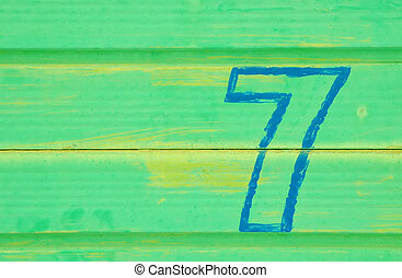 number 7 painted on a battered metal door