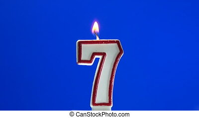 Number 7 - seven birthday candle burning - blow out at the...